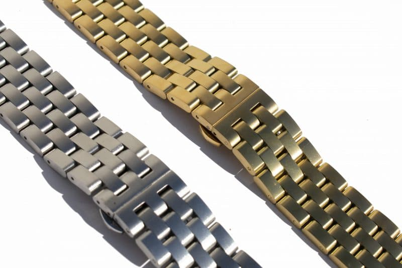 steel and gold watch straps