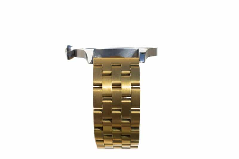 Steel watch strap and gold case- side view